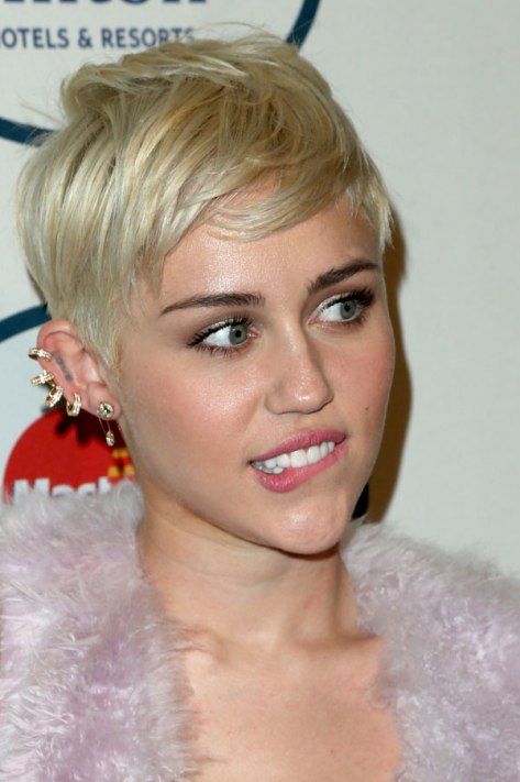 Miley Cyrus at the Clive Davis Pre-Grammys Gala 2014 earrings detail